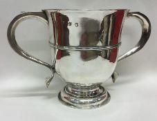 A good George I plain silver two handled trophy cu