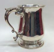 A good heavy Georgian silver baluster shaped mug.