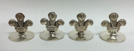 A heavy set of four silver menu holders in the for