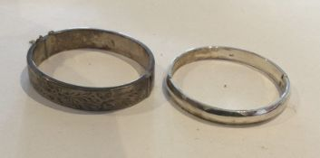 Two silver bangles. Approx. 50 grams. Est. £20 - £