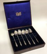 A cased set of six silver Apostle top spoons. Appr