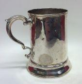 An early Georgian silver tapering mug on spreading