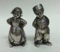 A pair of unusual silver cruets in the form of Dut