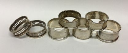 A collection of silver napkin rings. Various dates