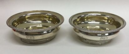 A pair of heavy circular silver salts with gilt in