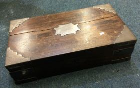A Colonial silver mounted wooden travelling case.