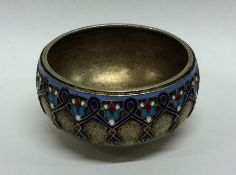 A Russian silver and enamelled salt with gilded de