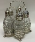 A George II solid silver five bottle cruet with pi