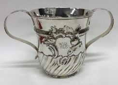 A George II silver two handled porringer with swir