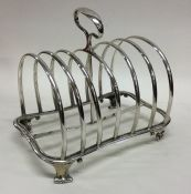 A good heavy seven bar toast rack. London. By Hunt