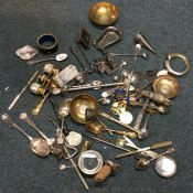 A large collection of silver plated sconces, opera