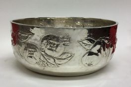 A heavy Continental silver chased bowl decorated w