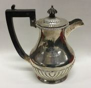 A silver half fluted water jug with hinged top. Bi