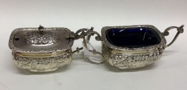 An embossed silver mustard pot together with match