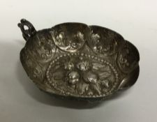A Continental embossed silver dish decorated with