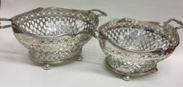 A fine pair of Edwardian silver dishes attractivel