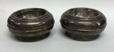 A pair of early Georgian circular silver trencher