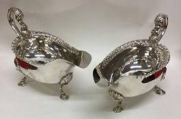 A heavy pair of Georgian silver sauce boats with g
