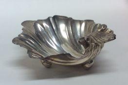 A Georgian silver scallop shaped salt on ball feet