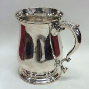 A large Georgian silver mug on spreading base. Lon