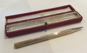 CARTIER: An attractive 9 carat pencil of fluted de