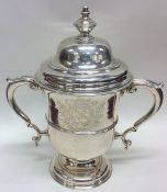 A large George II silver trophy cup and cover with