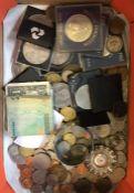 A box containing coins. Est. £30 - £50.