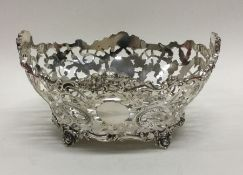 An attractive pierced silver basket with scroll de