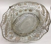 A rare large pierced George III silver basket deco
