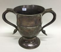 A heavy Georgian silver two handled trophy cup on