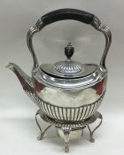 A silver half fluted bachelor's kettle on stand of