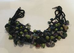 A large tapering hard stone necklace with silver c