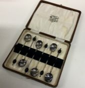 A boxed set of six silver plated bean top coffee s