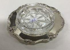 A heavy silver and cut glass preserve dish. Birmin