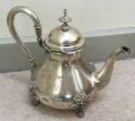 A Continental silver teapot with scroll decoration