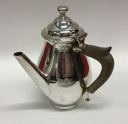 An unusual side handled silver baluster shaped jug