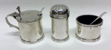 An Edwardian silver three piece cruet set. Birming