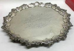 A heavy Georgian silver circular salver on three s