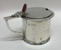 A large circular silver mustard pot with BGL. Lond