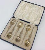 A cased set of six silver gilt teaspoons. Birmingh