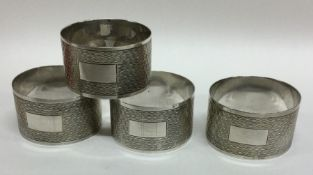 A good set of four silver engine turned napkin rin