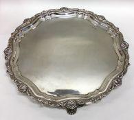 A good circular Edwardian silver salver with shell