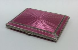 A good silver and pink enamelled cigarette case. B