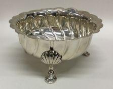 A good quality silver sugar bowl of half fluted de
