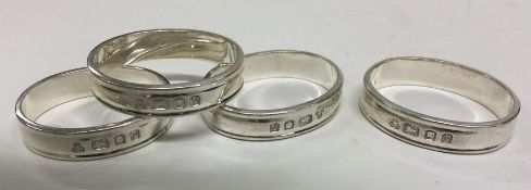 A good set of four heavy silver napkin rings. Lond