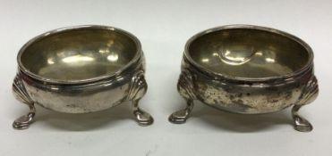 A good pair of Georgian silver salts on three spre