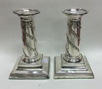 A good pair of Edwardian silver candlesticks with