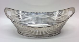 A Dutch oval silver bread basket attractively deco