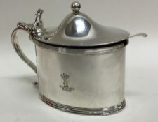 A heavy George III crested silver mustard pot with