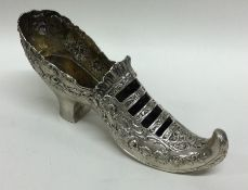 A large Continental silver model of a shoe with sc